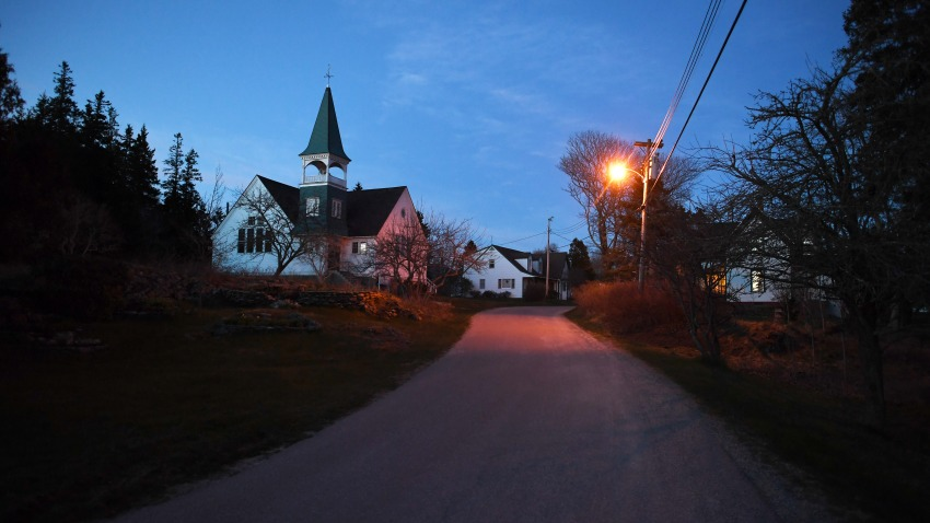 A road is illuminated by a street light on Thursday April 28, 2016 in Islesford, ME. Islesford is located on Little Cranberry Island, which is home to many lobstermen.