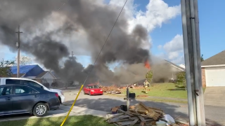 This screenshot from video shows the scene of the Navy airplane crash.