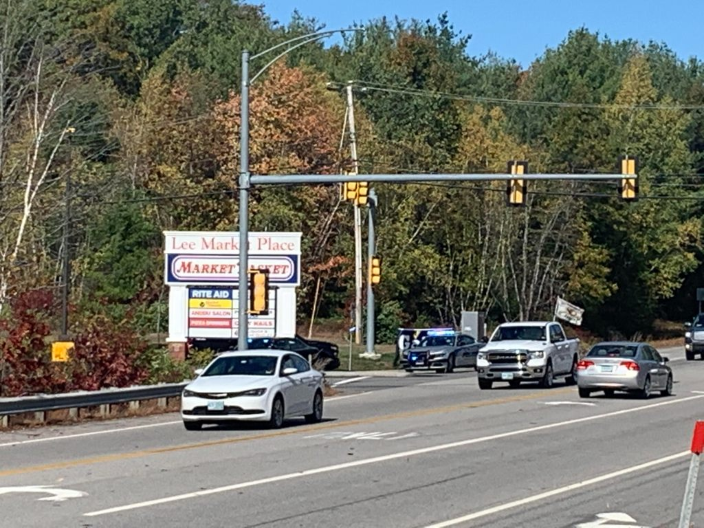 An armed subject who fired shots into the air, leading to a lockdown of the busy Market Basket shopping plaza in Lee, New Hampshire, on Saturday afternoon is now in police custody.
