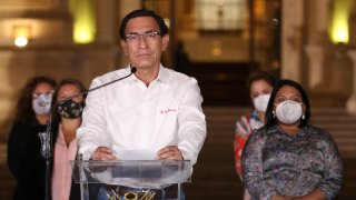 Peru's President Martin Vizcarra speaks in front of the presidential palace after lawmakers voted to remove him from office in Lima, Peru, Monday, Nov. 9, 2020. Lawmakers voted to impeach Vizcarra, accusing him of taking bribes years ago and poorly handling the country's response to the coronavirus pandemic.