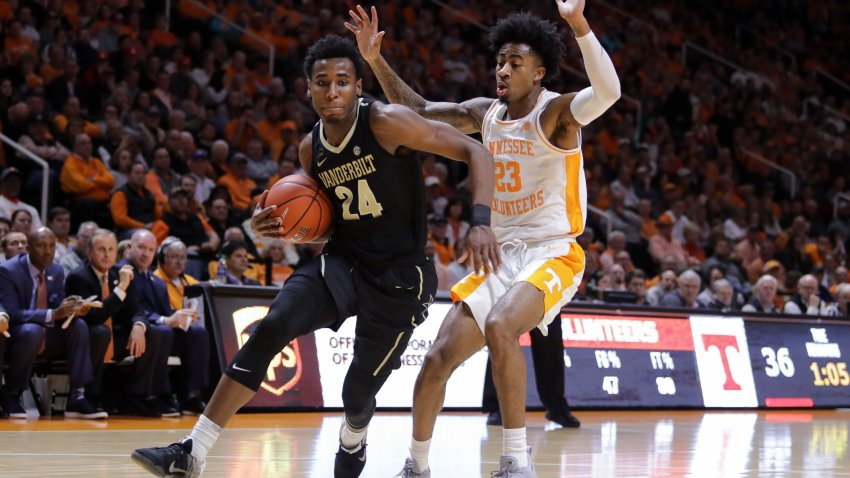 Aaron Nesmith #24 of the Vanderbilt Commodores drives with the ball past Jordan Bowden #23 of the Tennessee Volunteers during the first half of their game at Thompson-Boling Arena on February 19, 2019 in Knoxville, Tennessee.