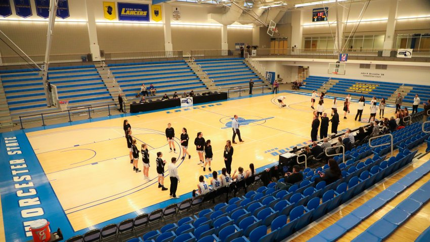 WORCESTER, MA - MARCH 12: Maynard High and Monson High make their introductions to an empty court with no fans during the MIAA Girls Division IV at Worcester State University's John Brissette Competition Court on March 12, 2020 in Worcester, MA.