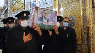 In this picture released by the Iranian Defense Ministry and taken on Saturday, Nov. 28, 2020, caretakers from the Imam Reza holy shrine, carry the flag draped coffin of Mohsen Fakhrizadeh, an Iranian scientist linked to the country's disbanded military nuclear program, who was killed on Friday, during a funeral ceremony in the northeastern city of Mashhad, Iran. An opinion piece published by a hard-line Iranian newspaper has suggested that Iran must attack the Israeli port city of Haifa if Israel carried out the killing of a scientist.