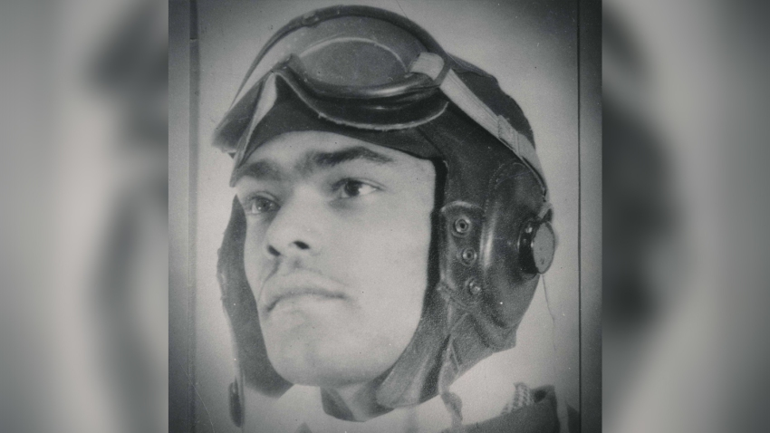 Franklin Macon poses for his official portrait as a Tuskegee Airman with his flight gear.