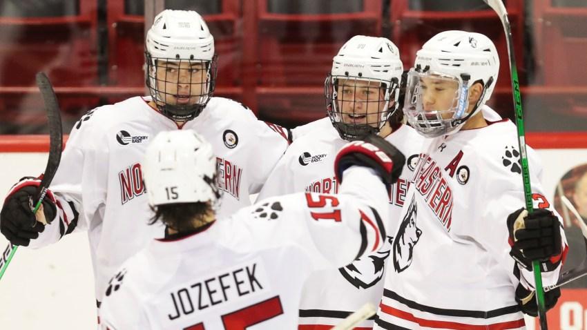 Northeastern Huskies players celebrate scoring