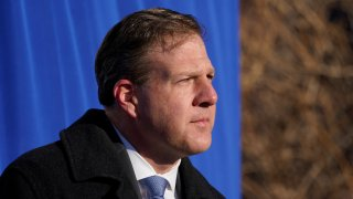 New Hampshire Governor Chris Sununu addresses a gathering outside the Elliot Hospital, Tuesday, Dec. 15, 2020, in Manchester, New Hampshire.