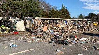A photo from Massachusetts State Police shows a tractor-trailer crash on I-93 in Canton.