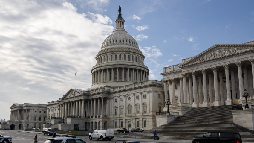 In this Dec. 20, 2020, file photo, Captiol Police vehicles sit outside the U.S. Capitol Building in Washington, D.C.