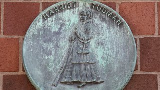 A plaque is seen on the exterior of the Harriet Tubman House on September 19, 2019 in Boston, Massachusetts.