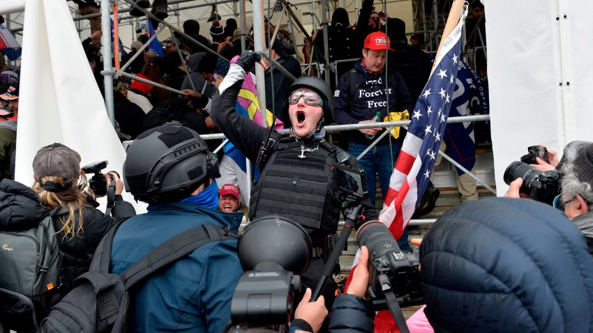 A man calls on people to raid the building as Trump supporters clash with police and security forces as they try to storm the Capital Building in Washington D.C on Jan. 6, 2021.