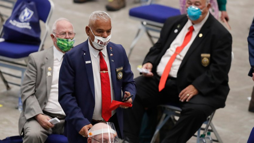 """New Hampshire Rep. Al Baldasaro (R-Londonderry) wears a """"Trump 2020"""" face mask as he walks among his colleagues during a legislative session in Durham, June 11, 2020, at the Whittemore Center at the University of New Hampshire."""