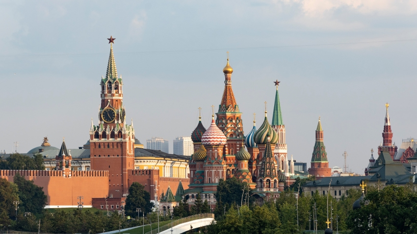 A view of the Kremlin with Spasskaya Tower and St. Basil's Cathedral in Moscow, Russia, early Saturday, June 20, 2020.