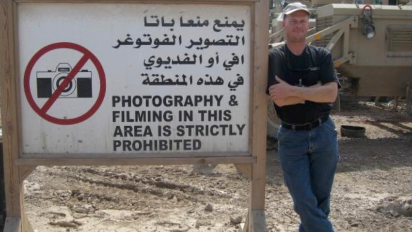 In this undated photo Mark Frerichs, a contractor from Illinois, poses in Iraq