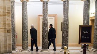 Senate Majority Leader Mitch McConnell (R-KY) heads towards his office from the Senate Floor at the U.S. Capitol on January 1, 2021 in Washington, DC. The Senate voted to pass the National Defense Authorization Act and override President Trump's veto for the first time during his presidency.