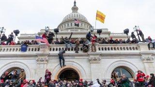 Protesters seen all over Capitol building where pro-Trump supporters riot and breached the Capitol. Rioters broke windows and breached the Capitol building in an attempt to overthrow the results of the 2020 election.