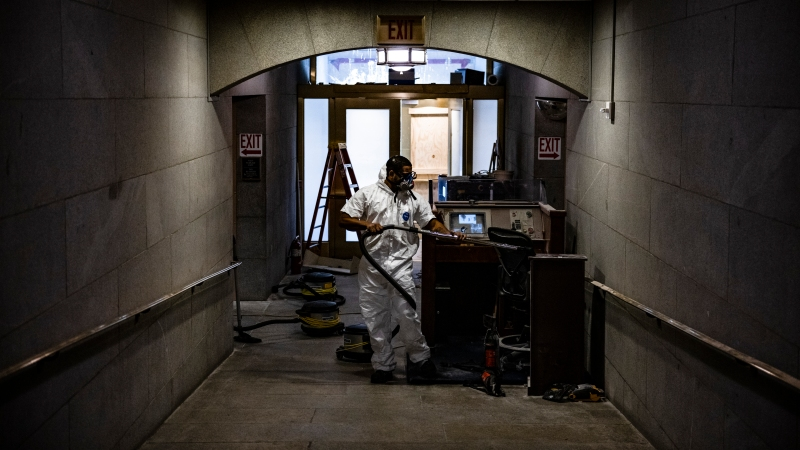 Photos: Cleanup Efforts Begin After Violence Shakes the Capitol