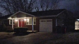 The house where neighbors say an 11-year-old girl found her parents dead from Covid-19 in St. Louis County, Mo.