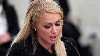 Paris Hilton speaks at a committee hearing at the Utah State Capitol, Monday, Feb. 8, 2021, in Salt Lake City. Hilton has been speaking out about abuse she says she suffered at a boarding school in Utah in the 1990s and she testified in front of state lawmakers weighing new regulations for the industry.