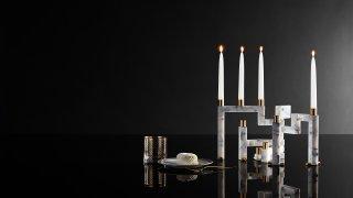 This image provided by Novita Italia shows a Vestalia white marble candlestick holder