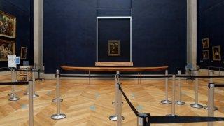 Leonardo da Vinci's Mona Lisa hangs on the wall in a deserted Louvre museum, in Paris.
