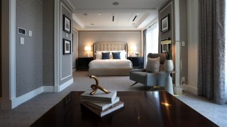 This file photo shows the master bedroom inside a Boston Harbor Hotel suite.