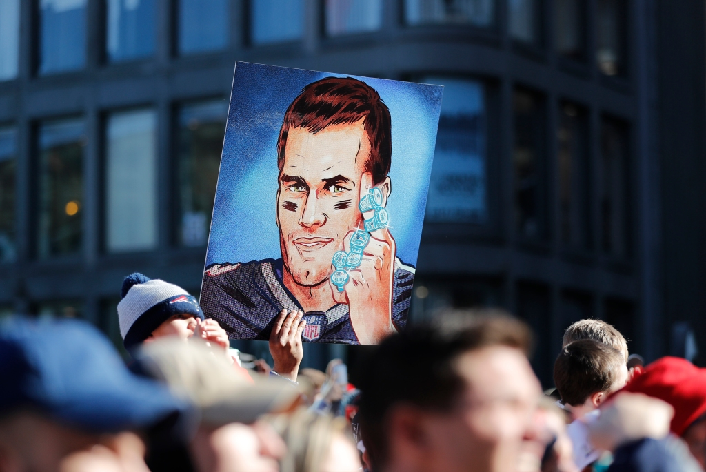 This Feb. 5, 2019, file photo shows a fan's picture of then-New England Patriots quarterback Tom Brady and his six Super Bowl rings during the Patriots' Super Bowl victory parade through the streets of Boston.