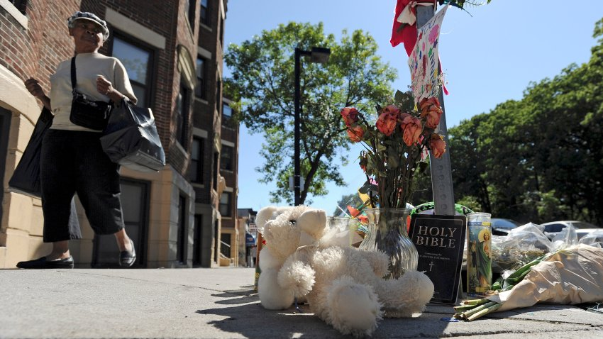 This Aug. 29, 2014, file photo shows a make-shift memorial at the corner of Blue Hill Avenue and Charlotte Street, where Dawnn Jaffier was shot the day of the Caribbean Festival.