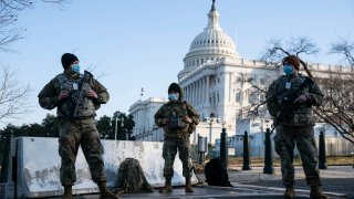 Members of the National Guard wear protective masks on duty outside of the U.S. Capitol on March 4, 2021 in Washington, DC.