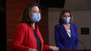 Representative Angie Craig, a Democrat from Minnesota, wears a protective mask while speaking during a new conference with U.S. House Speaker Nancy Pelosi, a Democrat from California, right, at the U.S. Capitol in Washington, D.C., U.S., on Friday, March 19, 2021.