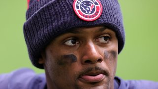 In this Dec. 27, 2020, file photo, quarterback Deshaun Watson #4 of the Houston Texans walks off the field after a 37-31 loss to the Cincinnati Bengals at NRG Stadium in Houston, Texas.