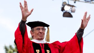 """actor Leonard Nimoy makes the gesture that made him famous when he played Spock on """"Star Trek"""" after receiving his honorary degree during a Boston University commencement ceremony on Nickerson Field in Boston"""
