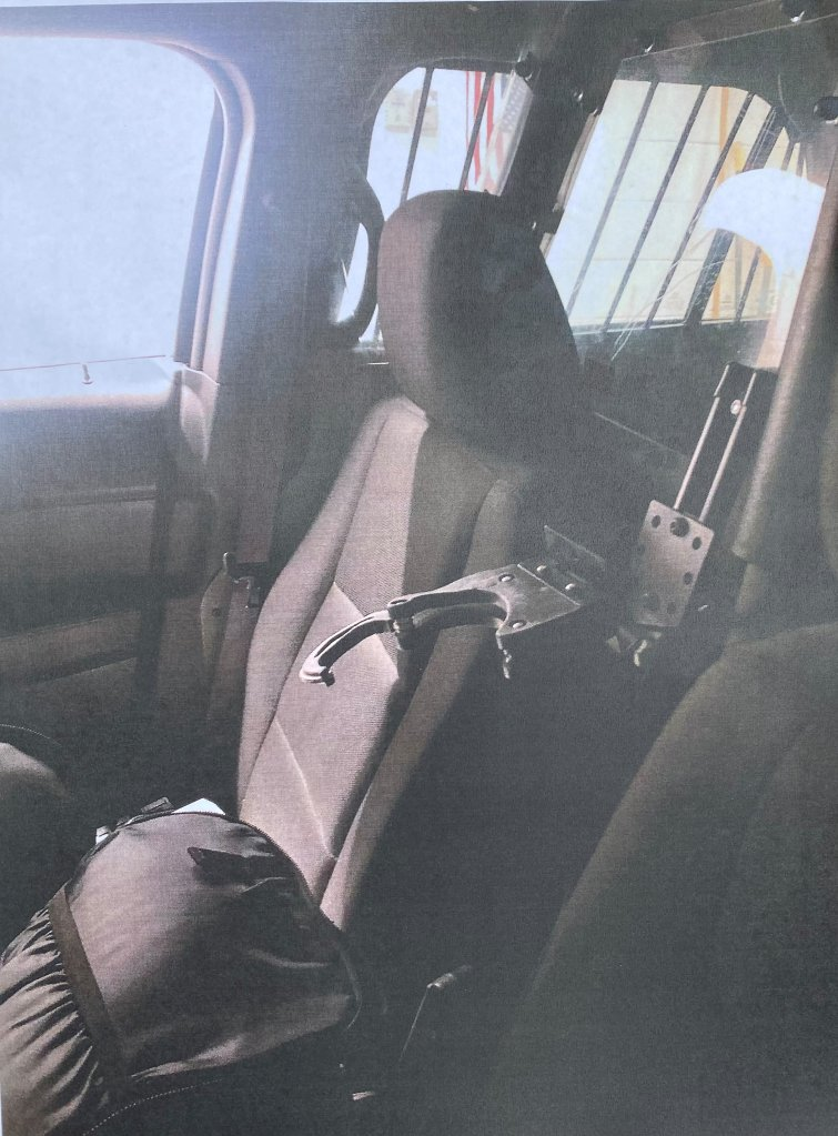 A damaged gun mount in a Rockland, Massachusetts, police cruiser