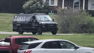 In this photo provided by WJZY, a tactical van from Caldwell County, North Carolina, sits on stand-by at a staging area in Boone, N.C., on Wednesday, April 28, 2021.