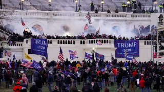 FILE - In this Jan. 6, 2021, file photo, rioters storm the U.S. Capitol in Washington.