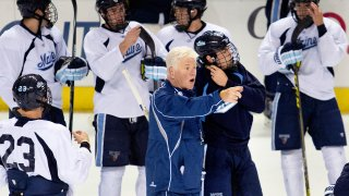 Red Gendron, coach of the UMaine men's hockey team, instructs his players in 2015