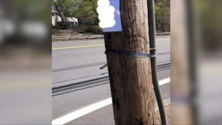 A sign with white supremacist speech (which has been blurred) was seen on a utility pole in Hanover, Massachusetts.