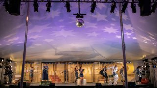 """This 2019 photo released by The Berkshire Theater Group shows a scene from their production of """"Godspell."""" The John-Michael Tebelak and Stephen Schwartz musical is celebrating its 50th anniversary this month, a golden milestone for a show with roots in the hippie era but which can still speak to those on TikTok."""