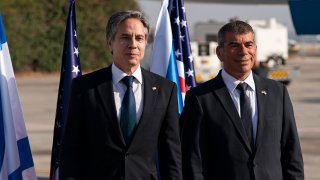 Secretary of State Antony Blinken, left, stands with Israeli Foreign Minister Gabi Ashkenazi, upon arrival at Tel Aviv Ben Gurion Airport, Tuesday, May 25, 2021, in Tel Aviv, Israel. Blinken has arrived in Israel at the start of a Middle East tour aimed at shoring up the Gaza cease-fire.