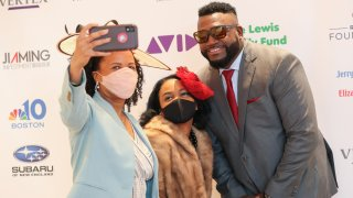 Boston Mayor Kim Janey and her daughter Kimesha take a selfie with David Ortiz at the Boston Arts Academy Honors in Norwood, Massachusetts, on Saturday, May 1, 2021.