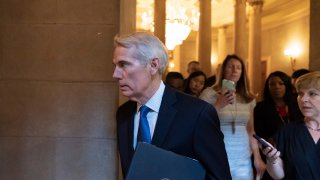 Sen. Rob Portman, R-Ohio, arrives for a meeting at the Capitol in Washington, Wednesday, June 23, 2021. Congressional negotiators and the White House appear open to striking a roughly $1 trillion deal on infrastructure, but they are struggling with the hard part — deciding who will pay for it.