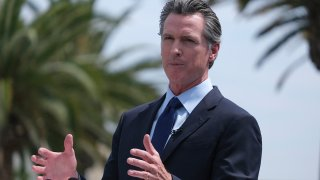 FILE - California Gov. Gavin Newsom talks during a news conference at Universal Studios in Universal City, Calif., on June 15, 2021.
