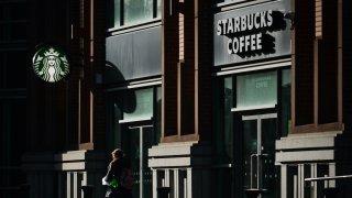 A person walks past a Starbucks Coffee in Dublin city center.