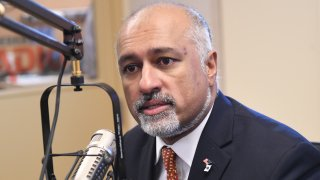 """This Jan. 23, 2018, file photo shows congressional candidate Abhijit """"Beej"""" Das, a North Andover Democrat, on Herald radio."""