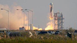 The New Shepard Blue Origin rocket lifts off.