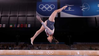 Suni Lee performs her uneven bars set in the gymnastics all-around at the 2020 Tokyo Olympic Games