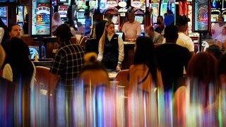 crowds walk through the casino during the opening night of Resorts World Las Vegas in Las Vegas