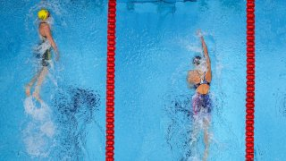 Ariarne Titmus, left, of Australia wins the final of the women's 400-meters freestyle ahead of Katie Ledecky, of the United States, at the 2020 Summer Olympics, Monday, July 26, 2021, in Tokyo, Japan.