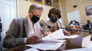 House Energy and Commerce Chairman Frank Pallone, D-N.J., left, and House Financial Services Committee Chairwoman Maxine Waters, D-Calif., go over their notes at the House Rules Committee