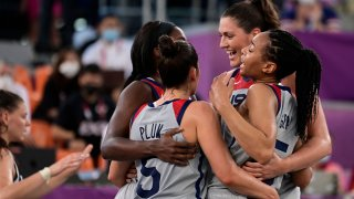 USA's teammates celebrate after wining at the end of the women's semi final 3x3 basketball match between US and France