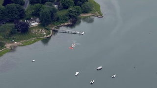 A U.S. Coast Guard helicopter searching for a woman who may have gone missing in Hingham Harbor Thursday.